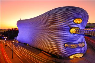 Photopgraph of the exterior of the Birmingham Bull Ring at night