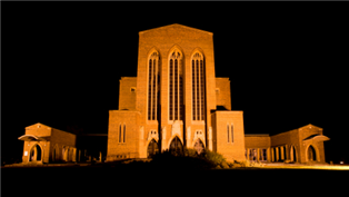 Photograph of Guildford Cathedral in Surrey illuminated at night